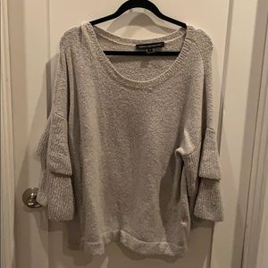 Gray sweater with statement sleeves.
